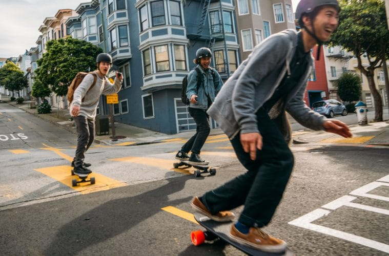 group of teens riding electric skateboards