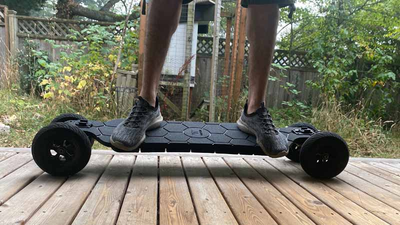 WowGo At2 with man standing on it