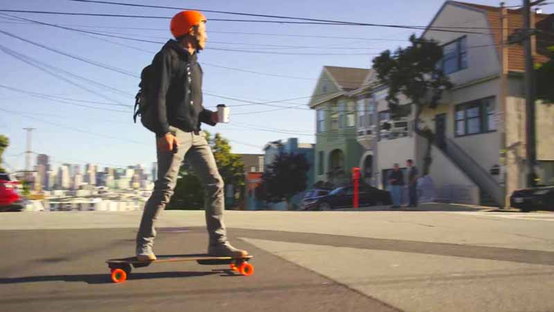 man commuting on electric skateboard