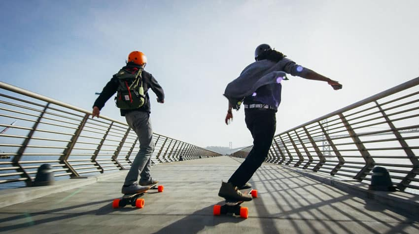 two man riding on electric skateboards