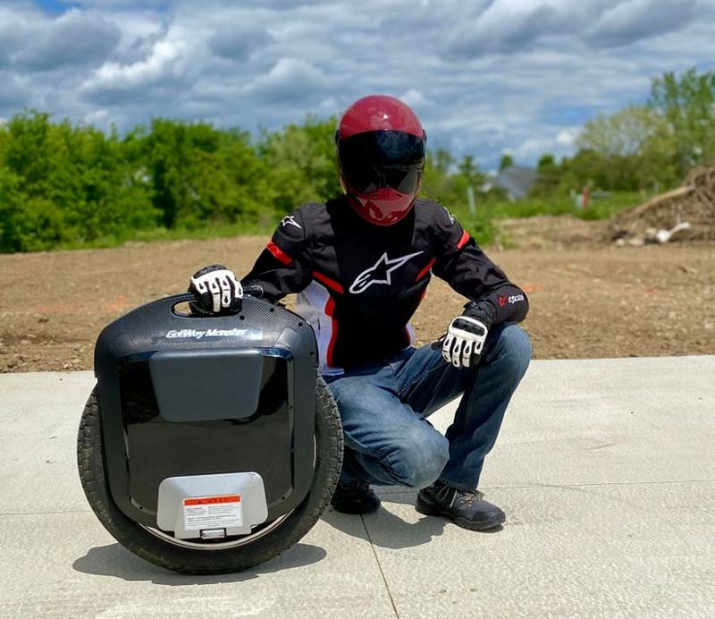 electric unicycle rider with protective gear