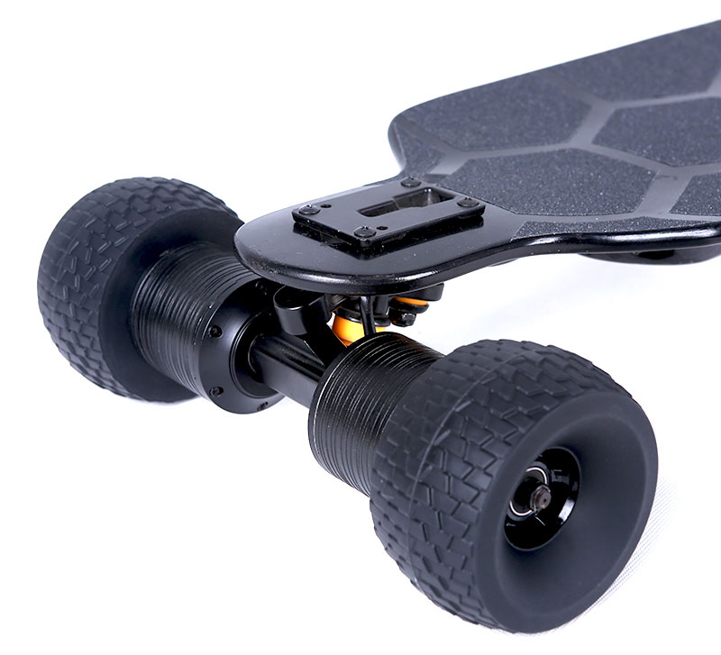 direct drive electric skateboard with black wheels